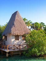 Мексика. The sea coast with the traditional house in Xcaret park near Cozumel, Mexico. Фото KKulikov - Depositphotos
