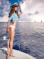 Attractive girl on a yacht at summer day. Фото Andrey Bayda - Depositphotos