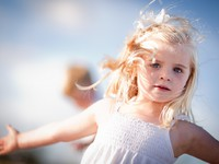 Adorable Blue Eyed Girl Playing Outside. Фото Andy Dean - Depositphotos
