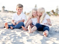 Adorable Sisters and Brother Having Fun at the Beach. Фото Feverpitch - Depositphotos