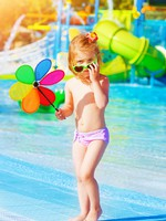 Little girl in aquapark. Фото AnnaOmelchenko - Depositphotos
