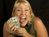 Woman on Black Holding Stack of Money. Фото Andy Dean - Depositphotos