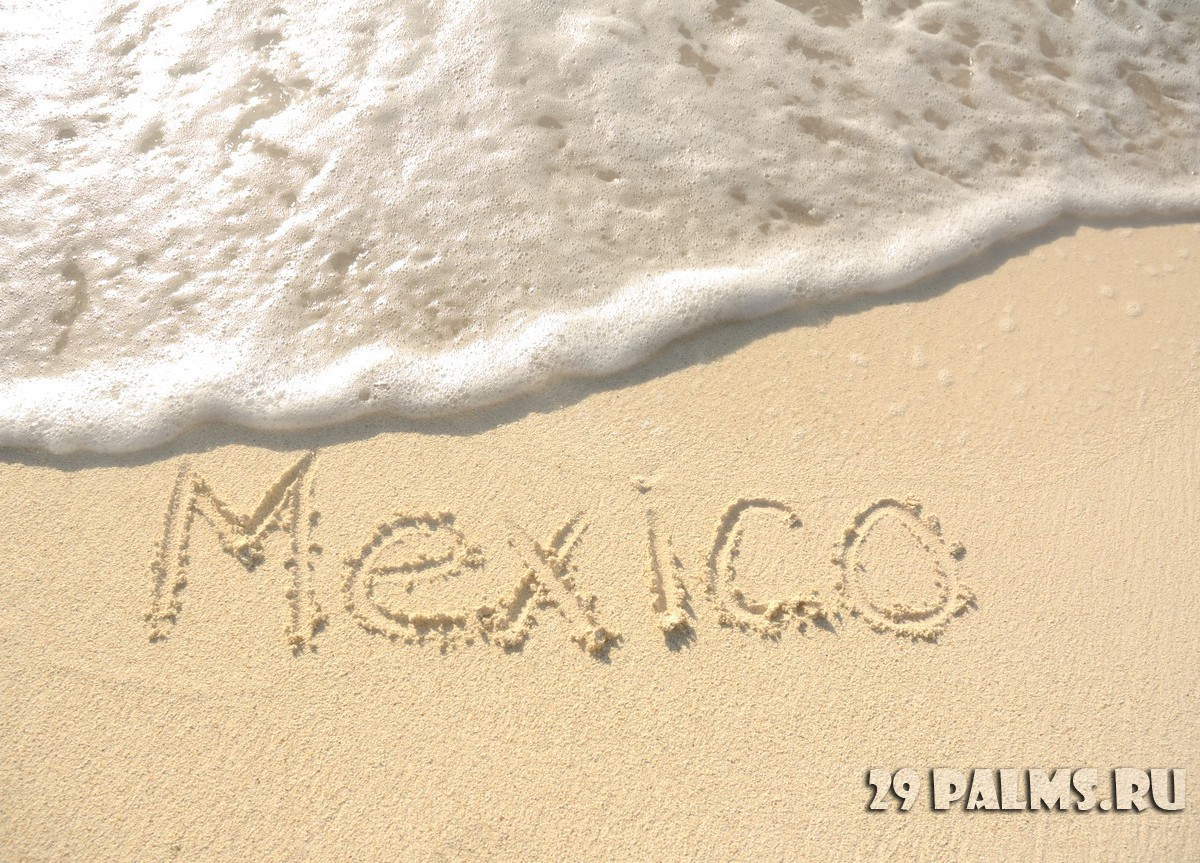 The Word Mexico Written in the Sand on a Beach. Фото Mark Herreid - Depositphotos