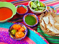 Mexican food varied chili sauces nachos lemon Mexico flavor. Фото TONO BALAGUER SL - Depositphotos
