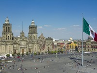 The zocalo in mexico city, with the cathedral and giant flag in the centre. Фото Dan Talson - Depositphotos