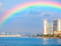Rainbow over shoreline of Puerto Vallarta, Mexico. Фото Alexey Stiop - Depositphotos