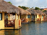 Tropical beach houses in Mexico. Фото Alexander Sviridov - Depositphotos