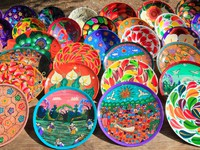 Clay ceramic plates from Mexico colorful traditional handcraft. Фото TONO BALAGUER SL - Depositphotos