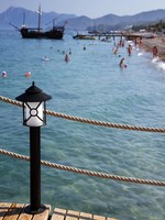 Lantern on landing stages, a beach in Turkey. Фото Andrey Konovalikov - Depositphotos_4628881