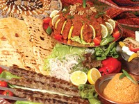 Sish kebab bulgur pilaf and pepper pure - traditional turkish sish kebab table. Фото Ismail Cihat Ozdol  - Depositphotos_15454731