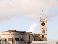 Барбадос. Parliament building Gothic architecture flag Bridgetown Barbados. Фото Robert Lerich - Depositphotos