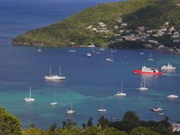 A view of the passenger ferry leaving Admiralty Bay, in Bequia. Part of St. Vincent and the Grenadines. Фото Verena Matthew - Depositphotos