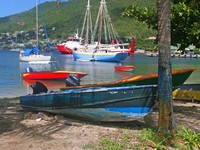 Сент Винсент и Гренадины. Nice boats in a bay on the island of Bequia in the Caribbean. Фото Verena Matthew - Depositphotos