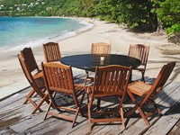 A patio and chairs along Friendship Bay Beach, on the island of Bequia in the Caribbean islands of the GrФото Verena Matthew - Depositphotos