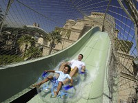 ОАЭ. Дубай. Atlantis, The Palm - Marine & Waterpark - Aquaventure Waterpark - Dad and Son on The Plunge