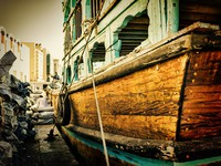 ОАЭ. Дубай. Loading a ship in Port Said in Dubai, UAE. The oldest commercia. Фото Observer - Depositphotos