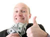 Successful businessman winner dollars. Фото Tracy Nors - Depositphotos