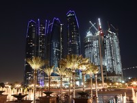 ОАЭ. Абу-Даби. Skyscrapers in Abu Dhabi at night. Фото Philip Lange - Depositphotos
