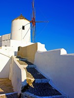 Греция. Санторини. Windmills of romantic Santorini. Фото Maugli - Depositphotos