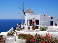 Греция. Санторини. Windmill on Santorini. Фото Yiannis Papadimitriou - Depositphotos