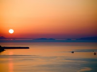 Греция. Санторини. Sunset in Santorini. Фото tepic - Depositphotos
