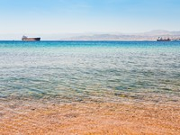 Иордания. Акаба. View on Israel mountain through Red Sea from Aqaba port. Фото Valery Voennyy - Depositphotos