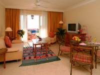 Иордания. Акаба. Movenpick Resort & Residence Aqaba. SITTING ROOM - ONE & TWO BEDROOM SUITES