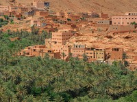 Panorama of a village among Moroccan hills, view from the road from Tinerhir to Todra gore. Фото yoka66 - Depositphotos