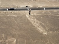 Peru. Tree and hand figures, Nazca lines in Peruvian desert,and observation tower. Фото Tomaz Kunst - Depositphotos