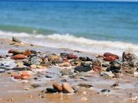 Испания. Коста Дорада. Sea stones Costa Dorada beach. Фото fantazista - Depositphotos