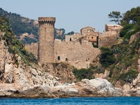 Historic castle on the Costa Brava - Spanish region. Фото Peter Kirillov - Depositphotos