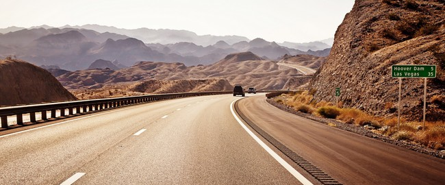 Empty desert Road to Las Vegas, USA. Фото Andrey Bayda - Depositphotos