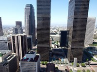 Los Angeles. Office towers and smaller building in mid day light. Фото trekandshoot - Depositphotos