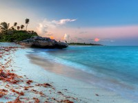 Amazing sunset at Caribbean Sea in Mexico. Фото Patryk Kosmider - Depositphotos